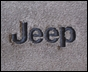 Jeep Front & Rear Carpeted Floor Mats (4 mats) for 2007-2011 4 Door Wrangler w/Jeep Logo by Lloyd Mats