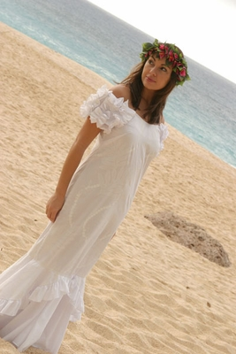 Posing in a beach wedding dress