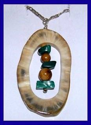 Northern Athapaskan Personal Power TalismanBanded Fossil Walrus Ivory WithMalachite and Dark Fossil Mammoth Beads