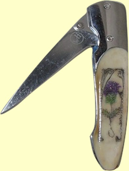 "<b><font size = 4 color =""#0000FF"">William Henry</font><br>Scrimshaw<br>Fossil Ivory<br>T-10 <br>Locking <br>Folding Knife<br>3 3/4"" Closed<br><font color =""#228b22""><i>Out of Stock</i></font></b>"