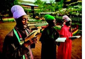 "Featured image is captioned: ""Jamaica (2011), Facing east, Rastafarians chant psalms from the King James Bible. Kingston, Jamaica."""