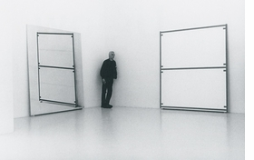 """Featured image is a photograph of painter Alan Uglow during his 2000 exhibition at the Onrust Gallery, reproduced from <a href=""""9783866783850.html"""">Alan Uglow</a>."""
