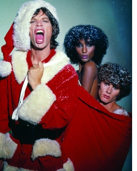 "Photographer Ara Gallant's dazzling photographs, like this wild holiday portrait of Mick Jagger, supermodel Iman, and model/photographer Paul Van Ravenstein from 1977, were truly a reflection of his personality. In her introduction to <a href=""http://www.artbook.com/9788862081207.html"">Ara Gallant</a>, Anjelica Houston explains, ""When Ara danced, we girls followed. He was in his element and so were we. He could pivot two six-foot models in Manolo's with the greatest of ease. He could transform a dance floor, make a room crackle, turn the lights down low."" <p>From all of us at DAP and ARTBOOK, we wish you Merry Christmas and a Happy New Year!"
