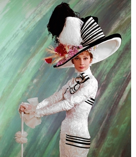 Cecil Beaton's photograph of Audrey Hepburn in 'My Fair Lady' costume is reproduced from 'Audrey Hepburn in Hats.'
