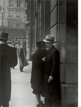 """Lovers at the Gare Saint-Lazare"" (c. 1937) is reproduced from 'Brassai.'"