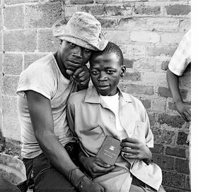 "Featured image, captioned, ""Young men with dompas, the identity document that every African over the age of 16 years had to carry,"" White City, Jabavu, Soweto, November 1972, is reproduced from 'David Goldblatt: Structures of Dominion and Democracy.'"