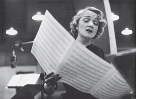 "Featured image is captioned: ""Marlene Dietrich at the recording studios of Columbia Records, singing songs she made famous during the Second World War. New York, 1952."""