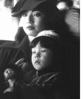 A somber portrait of Mini and her mother, in 'Come See the Paradise,' from 'Hapa Japan: Identities & Representations.'