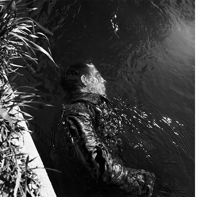 Lee Miller: Dead SS Guard, Floating in Canal, Dachau