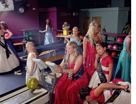 """Corby Carnival Queens Go Bowling, 1"" (2010) is reproduced from <I>Mark Neville: Fancy Pictures</I>."