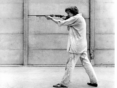 Niki de Saint Phalle shooting at the Impasse Ronsin, 1961
