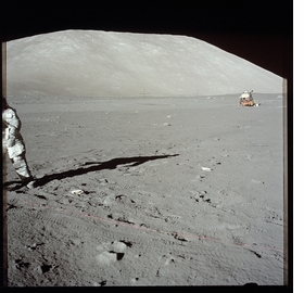 "Harrison ""Jack"" Schmitt as he deploys the SEP (Surface Electrical Properties) transmitter, part of the Apollo Lunar Surface Experiments Package (ALSEP). Photo by Eugene ""Gene"" Cernan. [Apollo 17], reproduced from 'The Moon 1968–1972.'"