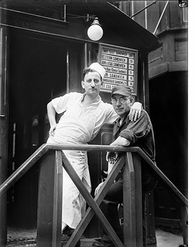 """Short Order Cook and Worker in Lunchroom Doorway on Second Avenue, New York City,"" 1932, is reproduced from <i>Walker Evans: Aperture Masters of Photography</i>."