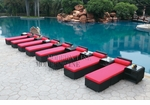 All-Weather Collection Water-Resistant Black Rattan Set of Eight Loungers and Nine Coffee Tables  with Red Pillows and Cushions