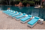 All-Weather Collection Water-Resistant White Rattan Set of Eight Loungers and Nine Coffee Tables  with Blue Pillows and Cushions