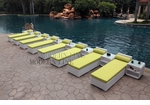 All-Weather Collection Water-Resistant White Rattan Set of Eight Loungers and Nine Coffee Tables  with Green Pillows and Cushions