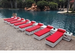 All-Weather Collection Water-Resistant White Rattan Set of Eight Loungers and Nine Coffee Tables  with Red Pillows and Cushions