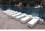 All-Weather Collection Water-Resistant White Rattan Set of Eight Loungers and Nine Coffee Tables  with White Pillows and Cushions
