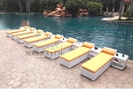 All-Weather Collection Water-Resistant White Rattan Set of Eight Loungers and Nine Coffee Tables  with Yellow Pillows and Cushions