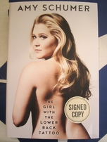 amy schumer autographed the girl with the lower back
