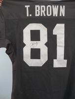 Tim Brown autographed Oakland Raiders authentic Reebok black game model jersey