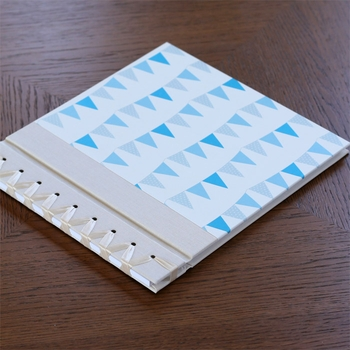 baby's first book - blue bunting by rag & bone bindery