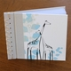 baby's first book - blue giraffe by rag & bone bindery