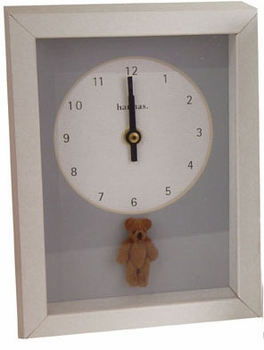 blue clock with teddy bear