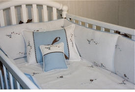 blue flowers and vines crib bedding