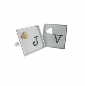 framed silver cuff links with raised and cutout accents