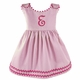 girl's pink pique dress with bright pink ric rac