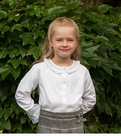 hand smocked silver trimmed blouse