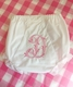 personalized diaper cover with single initial and berries in pink