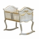 silver gold cradle with applique moulding and caning