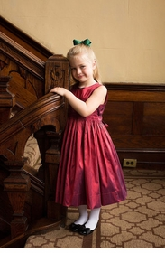 sleeveless hand-smocked ruby red silk dress