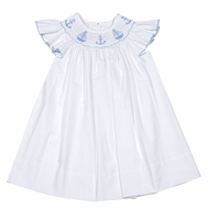 Petit Bebe by Anavini Baby / Toddler Girls Blue Smocked Anchors & Sailboats on White Poplin Dress