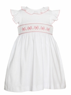 Petit Bebe Knits Infant / Toddler Girls White Dress - Smocked Pink Bows