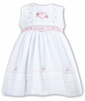 68305967f86 Sarah Louise Girls Sleeveless Smocked White Dress with Pink Heart Embroidery