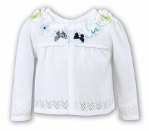 Sarah Louise Girls White Pointelle Bolero Sweater with Ruffle and Blue / Green Bows