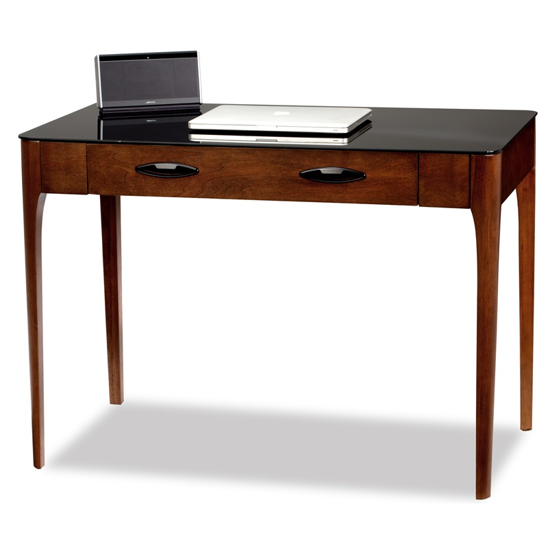 writing desk with keyboard drawer L-desk configuration offers abundant work surface while maintaining a  streamlined profile pencil drawer in return converts to a keyboard tray for  computer.