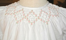 Girl's Heirloom Smocked Dress in White with Embroidered Pink Rosebuds and Pearls by Highland Porch
