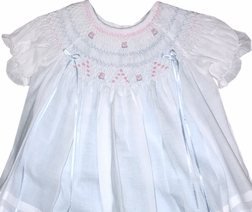 Will'Beth Girl's Smocked White with Blue Underlay Dress with Blue and Pink Rosebuds