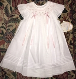 Will'beth Smocked Dress for Girls in White with Pink Accents.