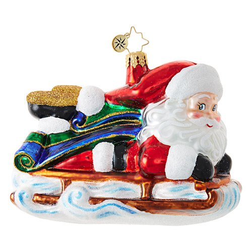 "Christopher Radko Glass Ornament - ""Sledding Santa"""
