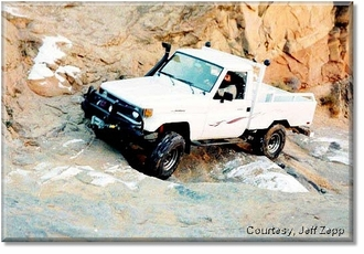 The diesel grunts and the tires chirp on the icy rocks of the waterfall...
