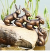 Helping Hand Rabbits Garden Sculpture by SPI Home