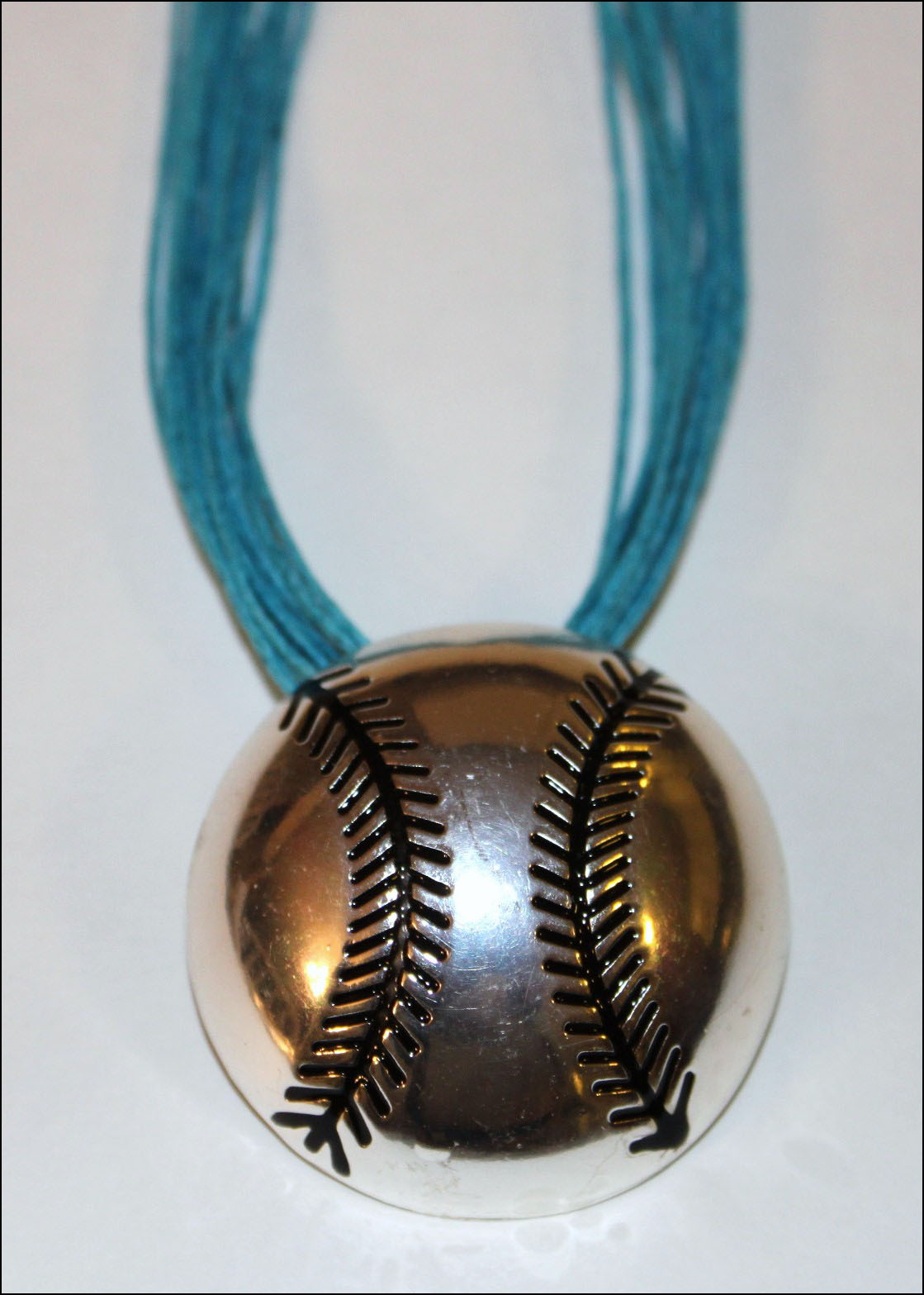 Silver Baseball Clip-on Pendant with Teal Blue Multistrand Necklace