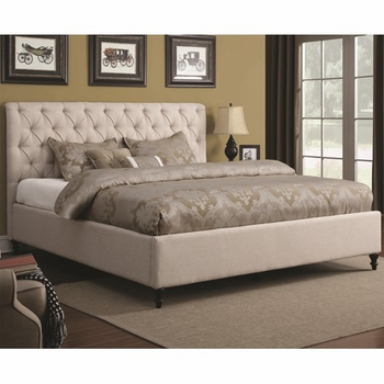 King Upholstered Bed with Tufted Headboard and Turned Wood Feet