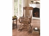 Wood Rocking Chair with Ornamental Headrest and Oak Finish
