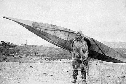 Eskimo Carrying Kayak Nome, Alaska Photo Print